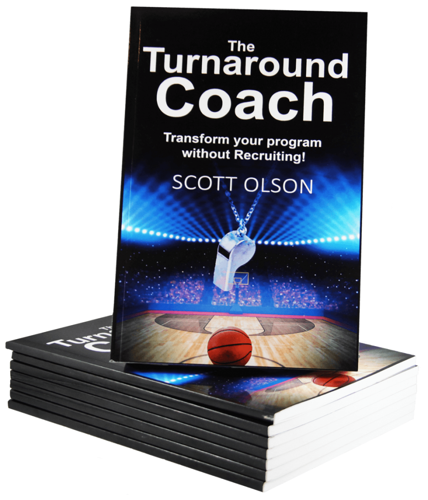 """""""The Turnaround Coach"""" book on top of a stack of books."""